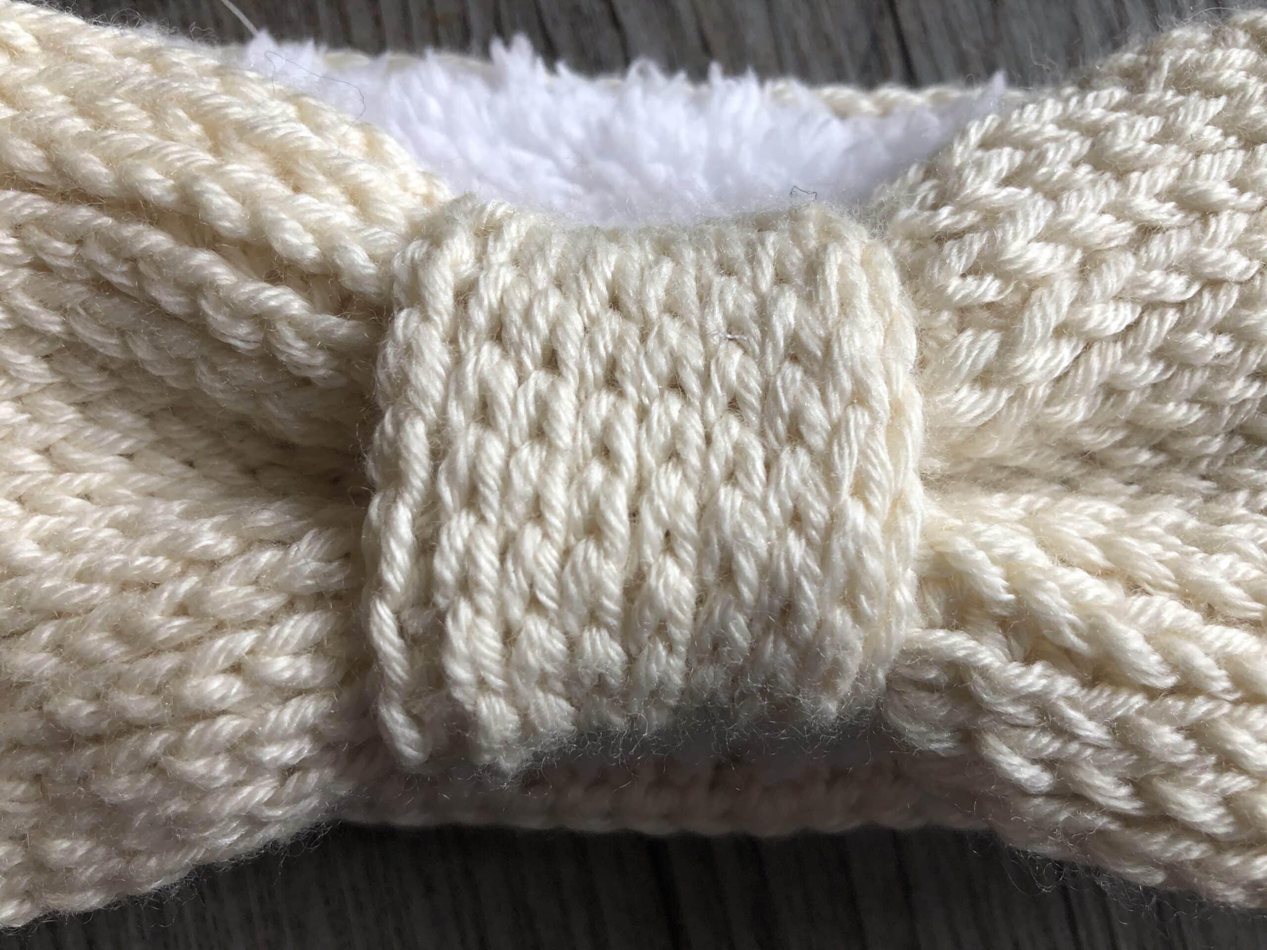 centre tie of a crochet winter ear warmer