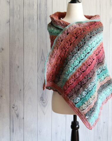 pink and blue lacy crochet shawl