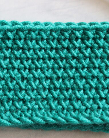green fabric close up cross stitch