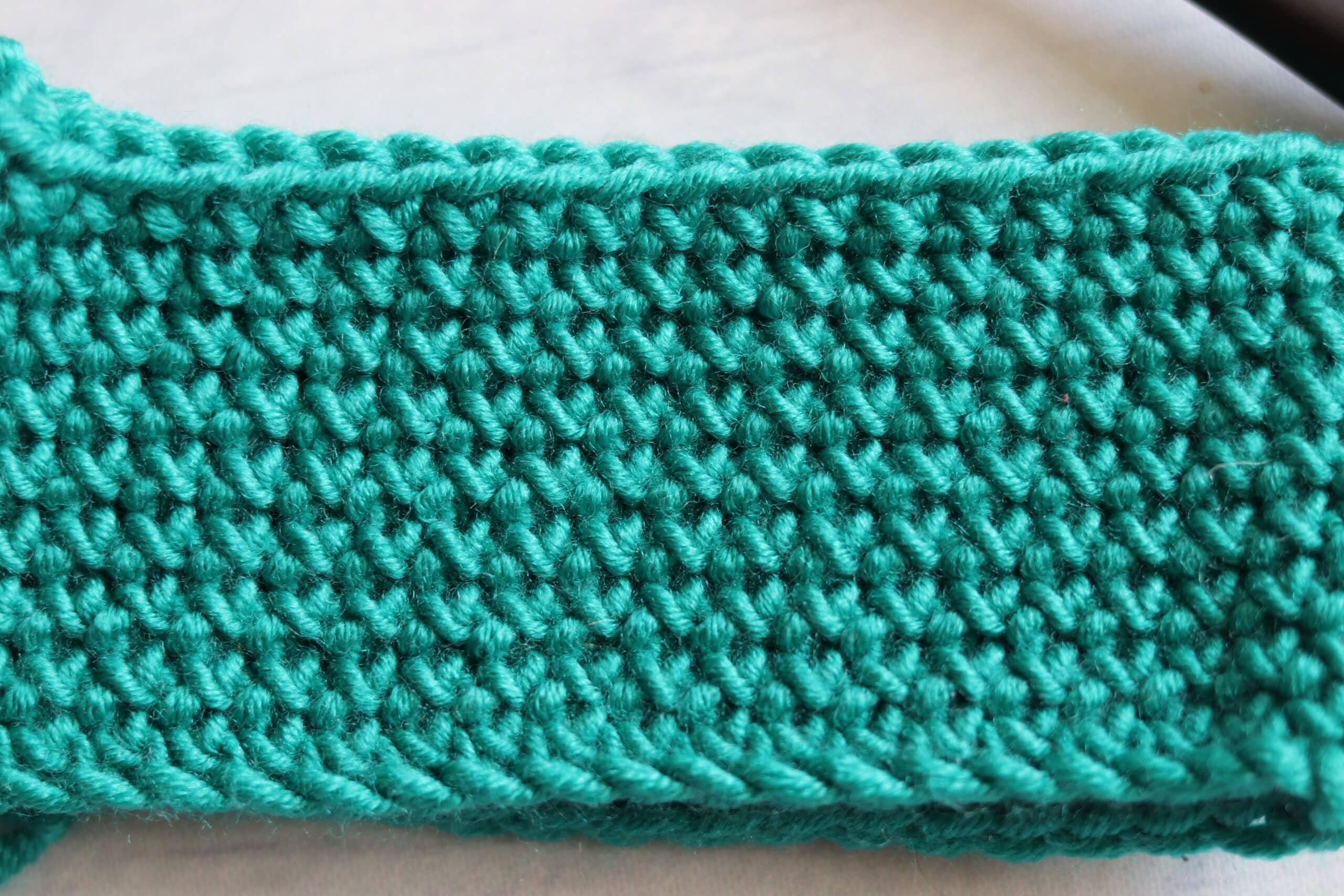 green fabric close up cross stitch