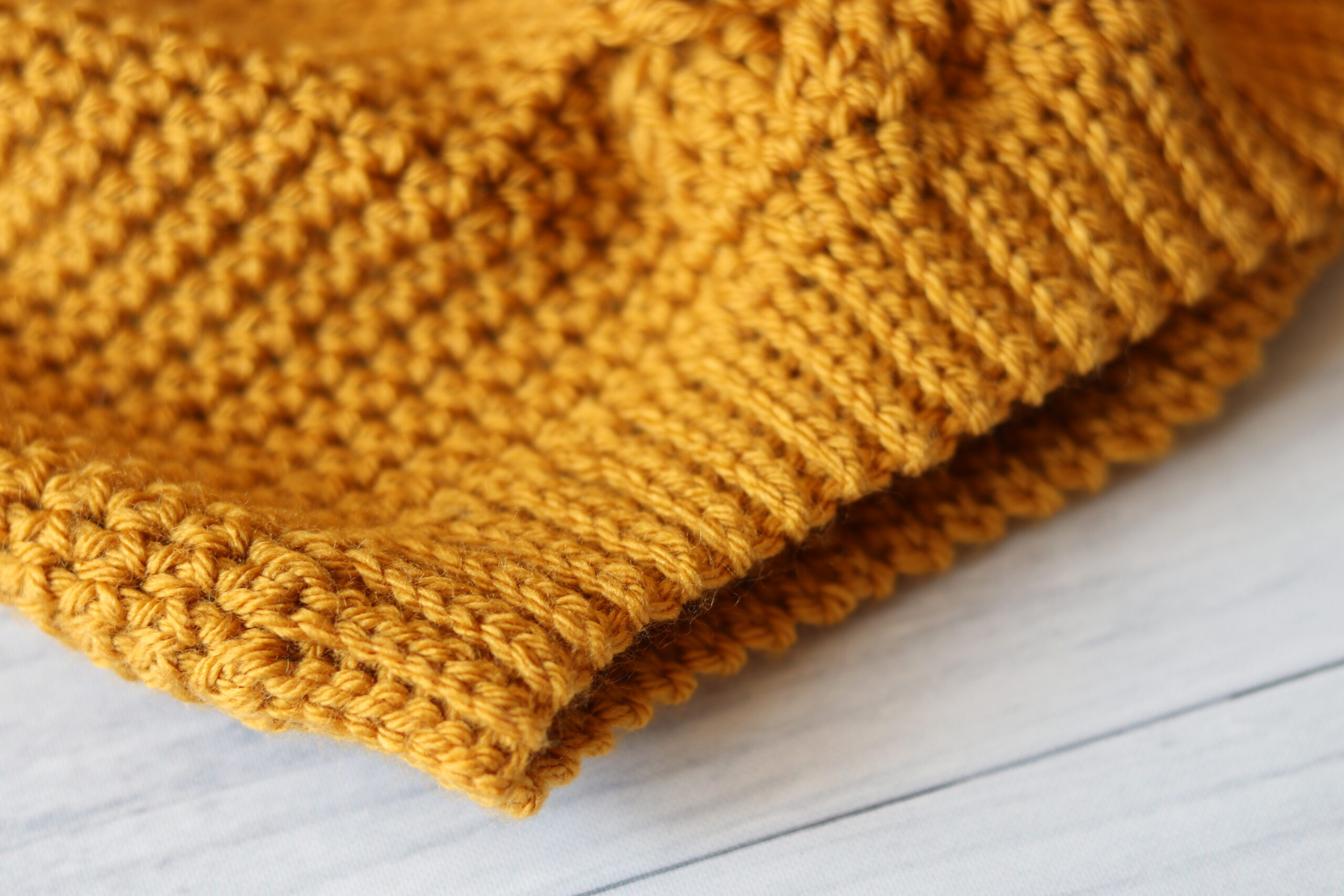 close up crochet hat yellow slip stitch brim