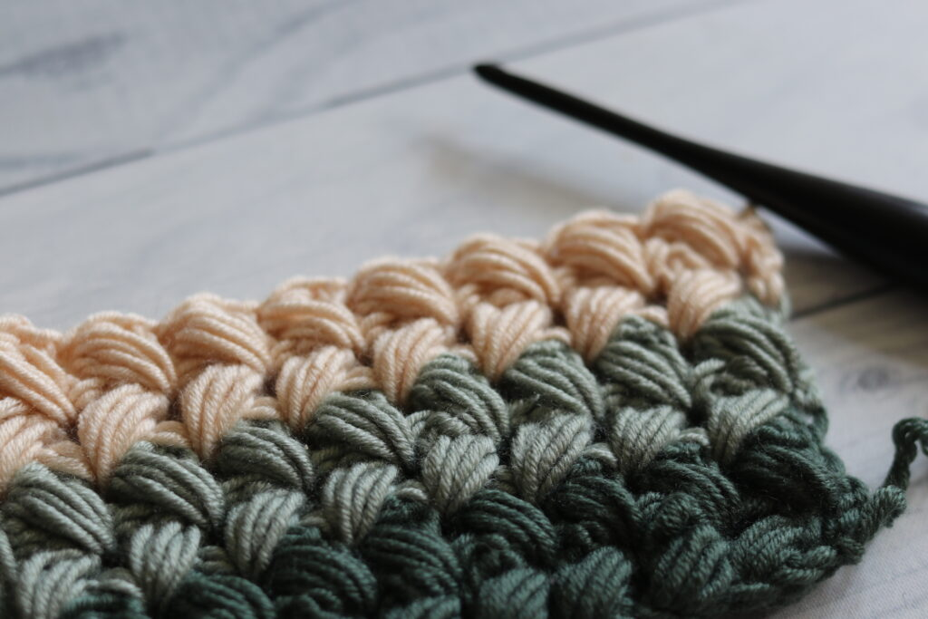 Braided Puff stitch shown with crochet hook