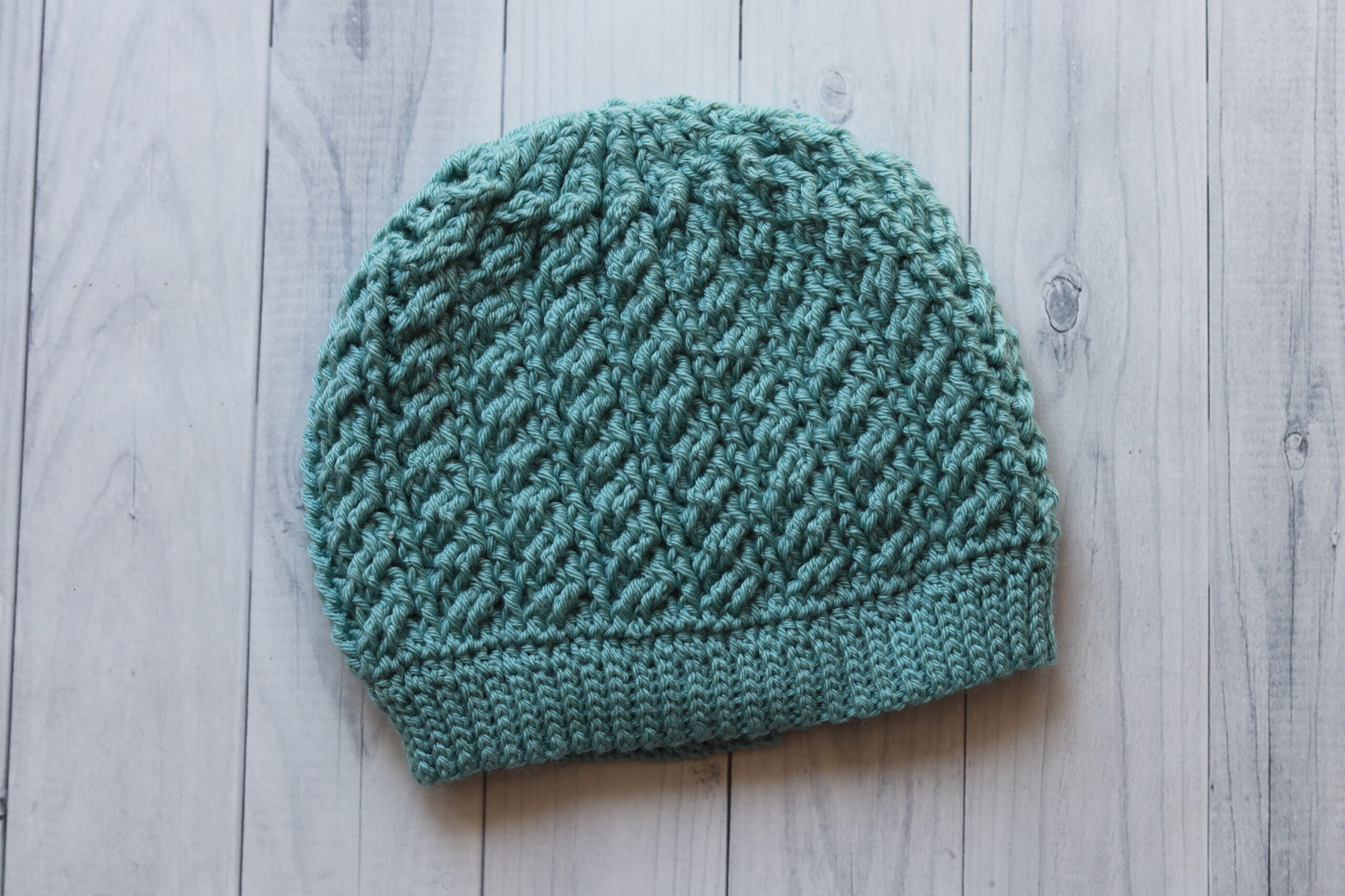 blue textured hat on white background