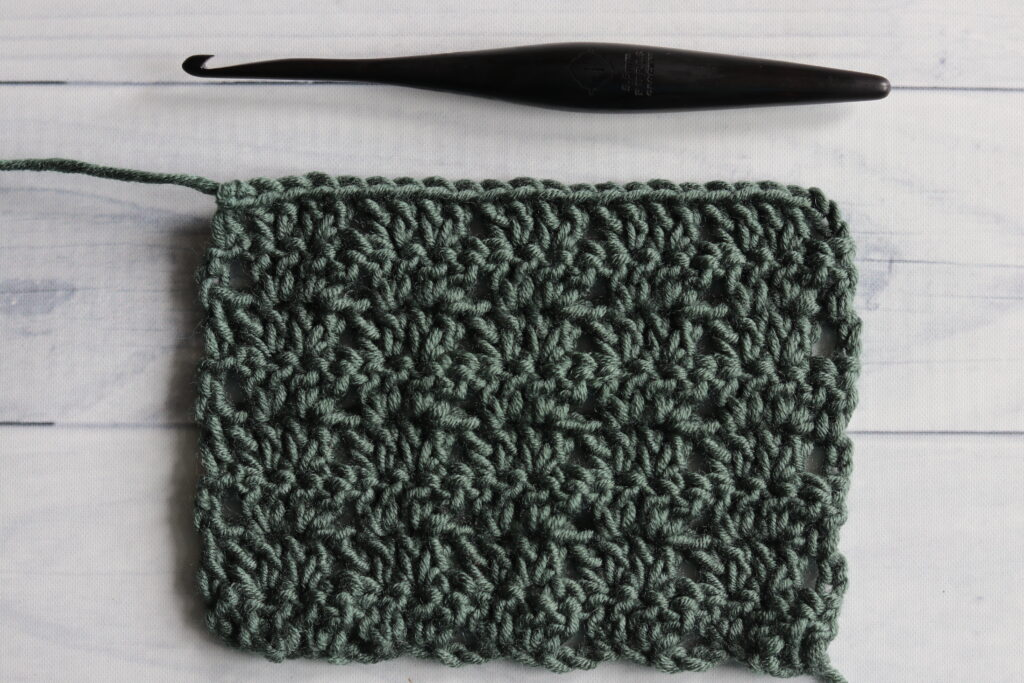 Twin V Stitch green crochet wooden hook white background
