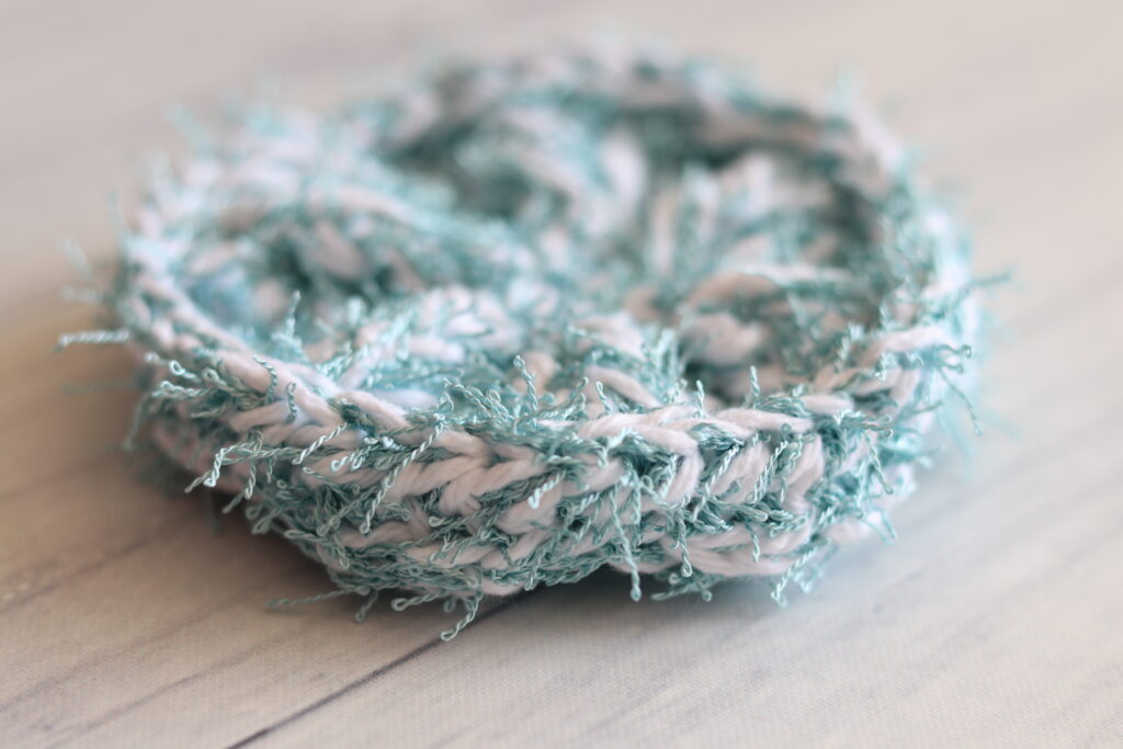 close up side view of the crochet scrubby