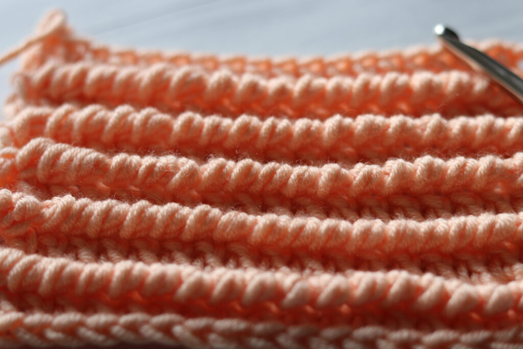 textured ridged crochet stitch in coral peach colour