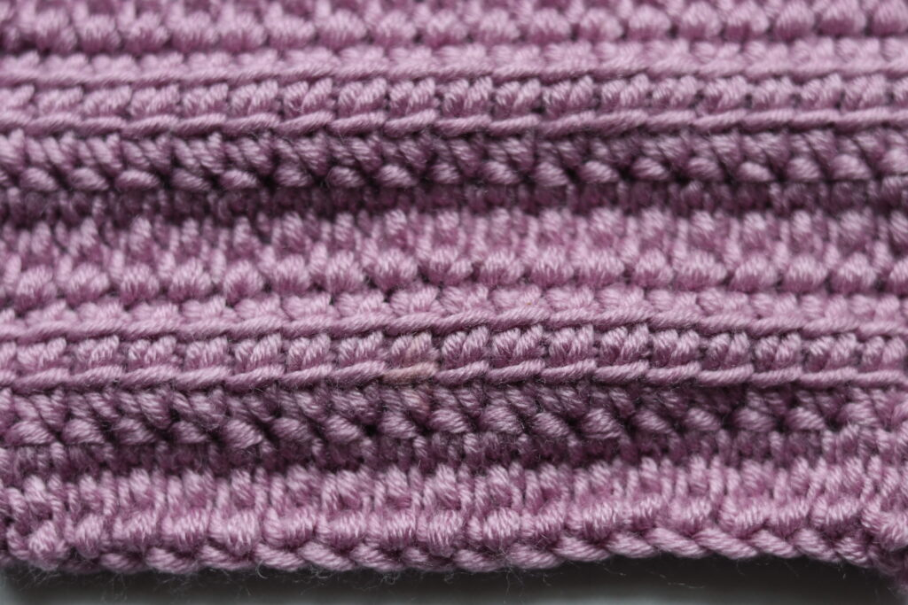 close up of crochet stitches, pink