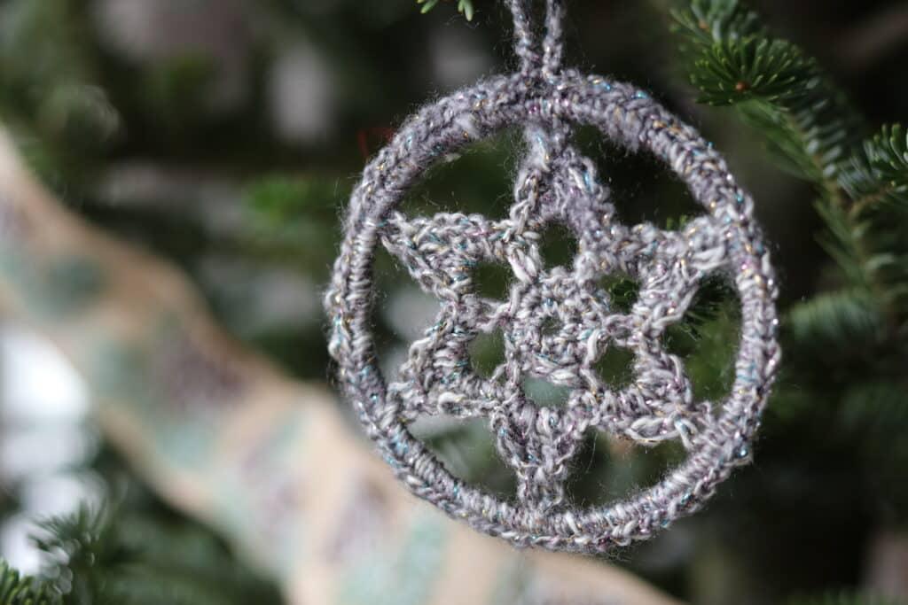 crochet star Christmas ornament grey with sparkle