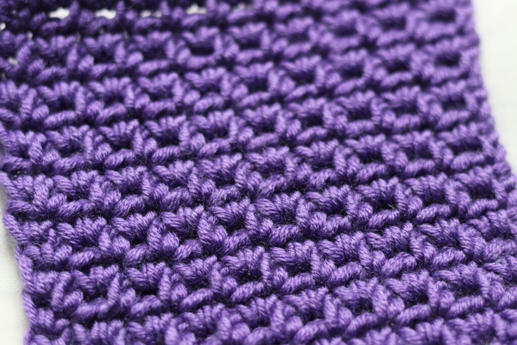 purple swatch of a single crochet and chain stitch pattern