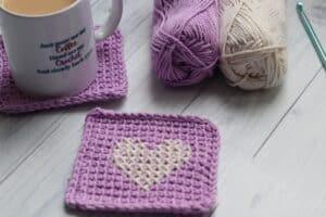 purple mug rugs crochet in Tunisian simple stitch