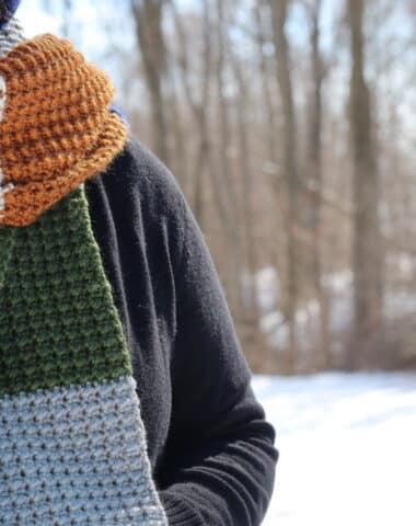woman wearing the terra nova crochet scarf