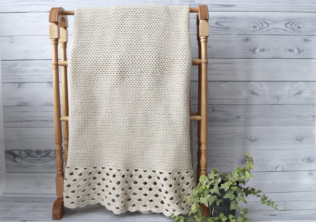 white crochet blanket with lace edging