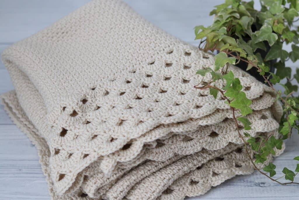 white crochet afghan folded