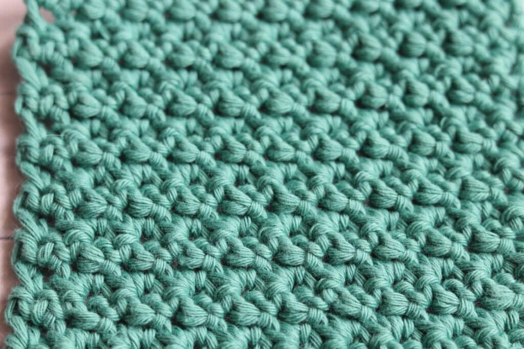 close up of the crochet raspberry stitch