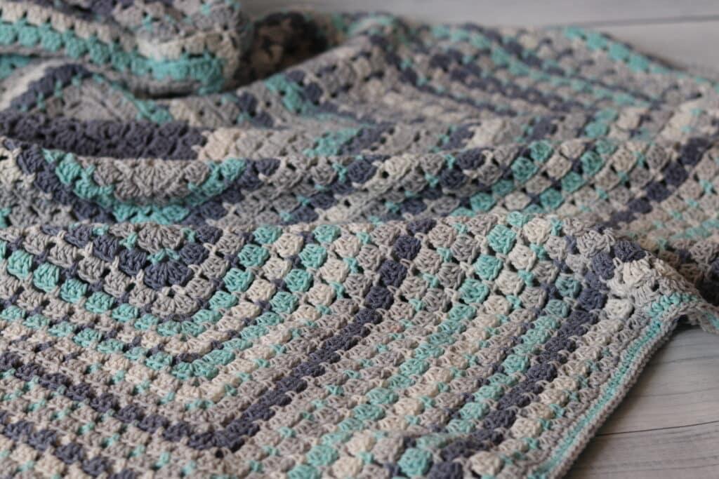 flat lay of summer breeze crochet throw