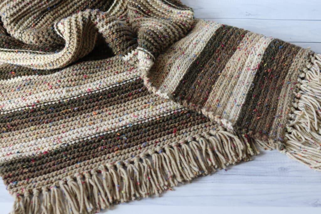 crochet blanket laying on flow