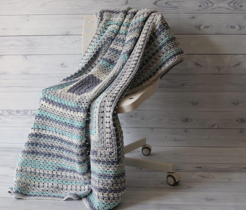 blue white and grey crochet blanket