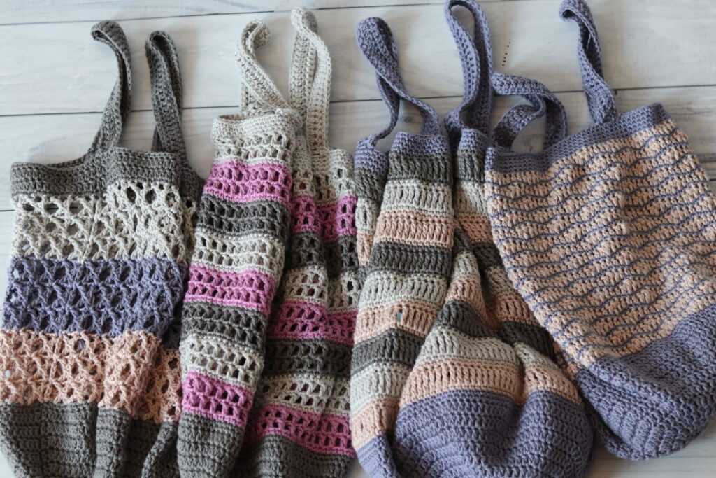 four crochet market bags