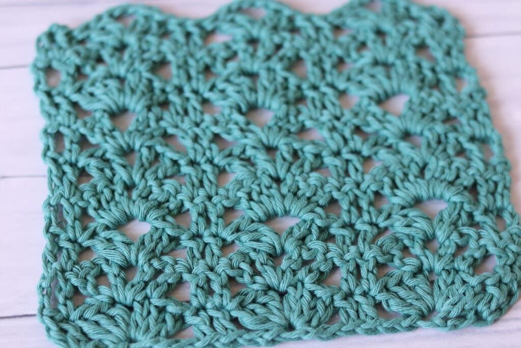 close up of a crochet shell stitch