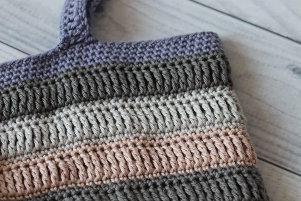 close up of a crochet market bag handle