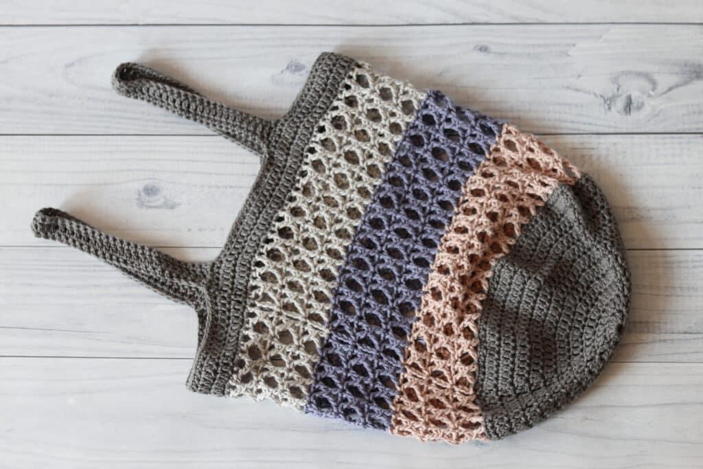 crochet market bag in pink purple and grey