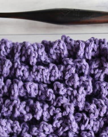 chain loop crochet stitch shown in purple alongside a wooden crochet hook