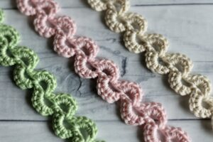 close up of crescent lace crochet bookmark