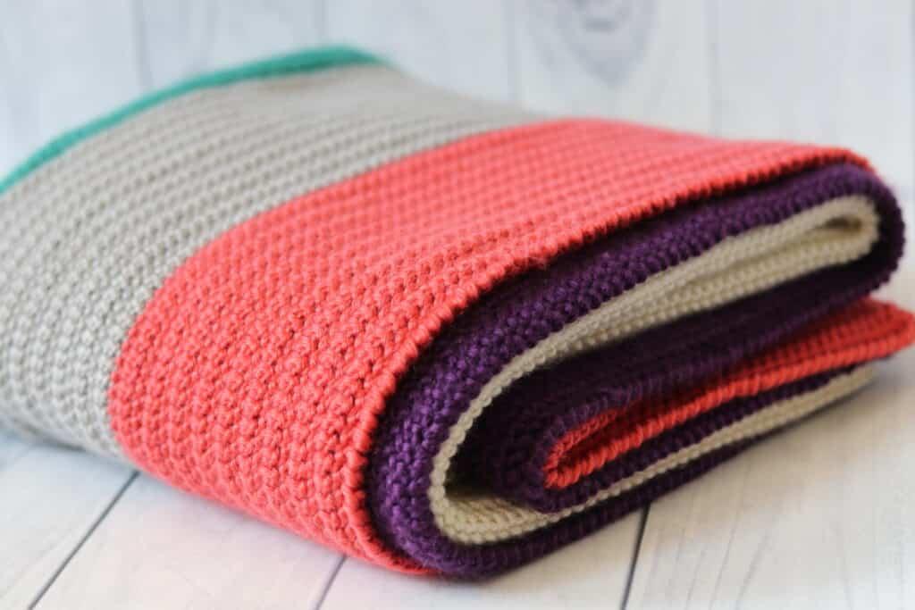 crochet blanket folded on floor