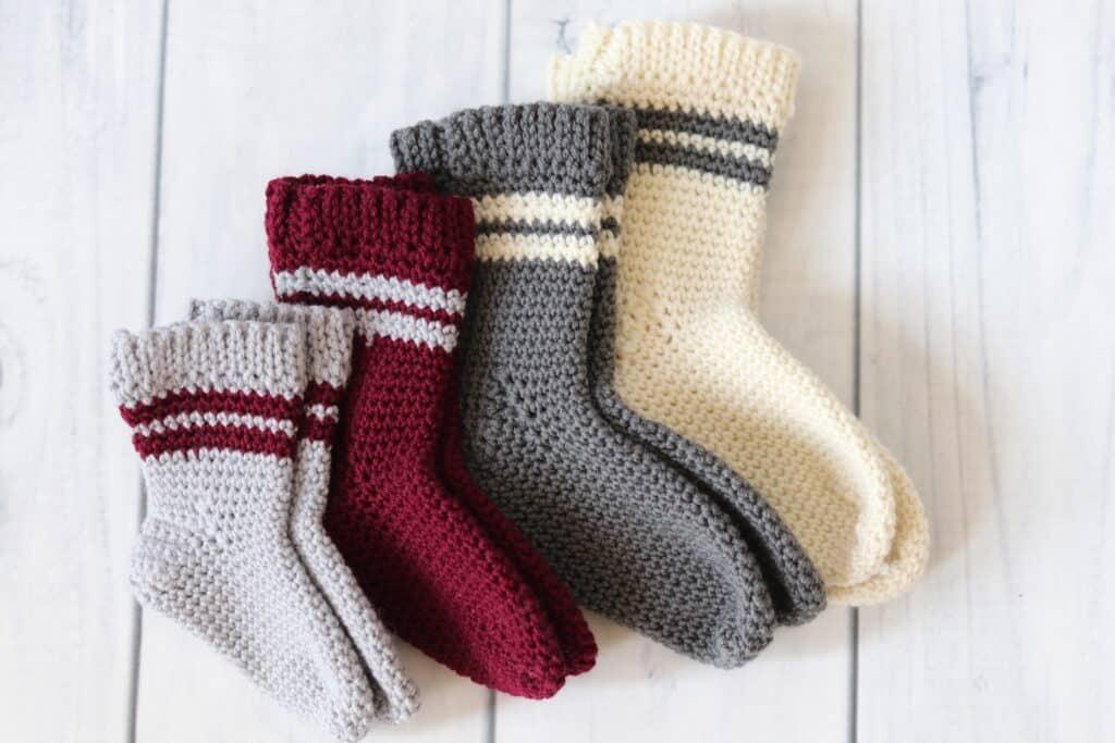four pairs of crochet baby socks