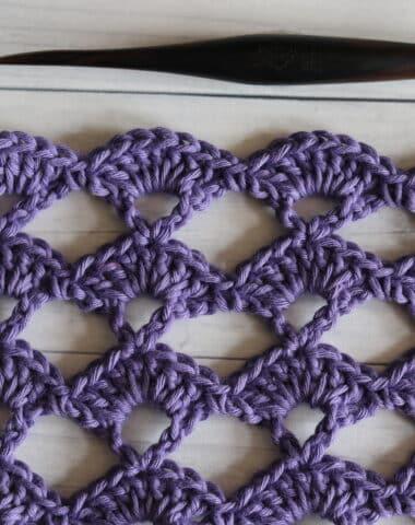 the open shell crochet stitch worked in purple yarn