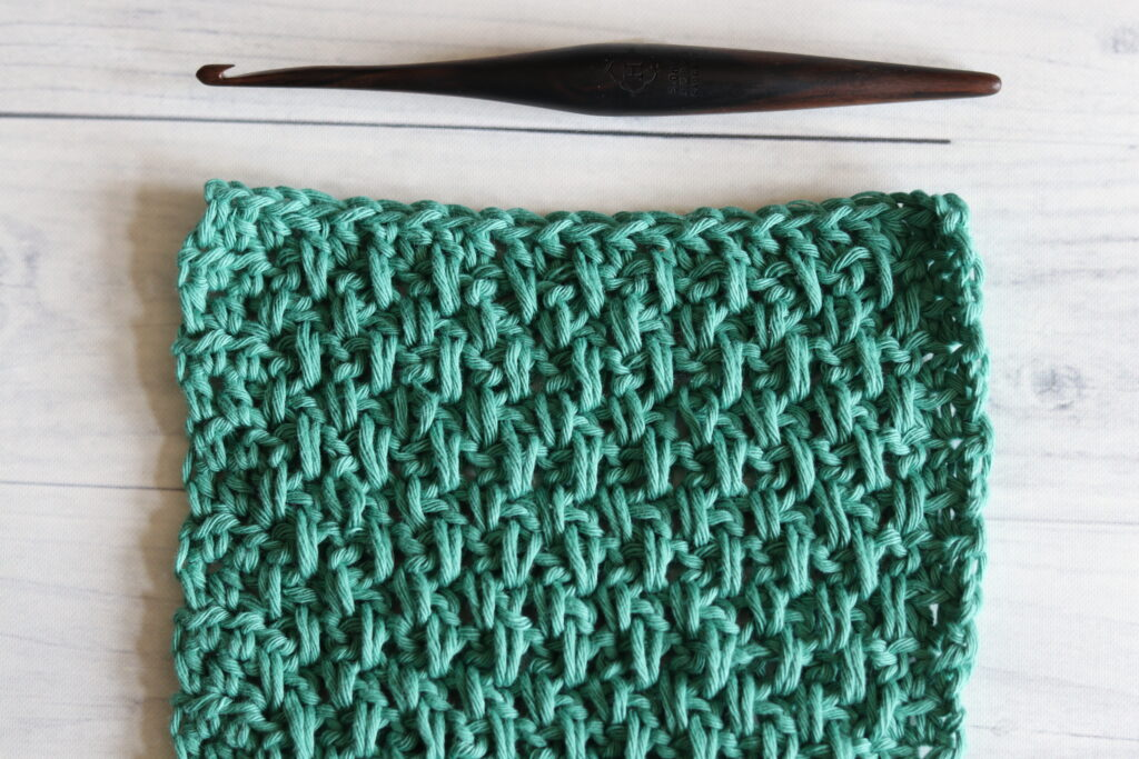 the extended moss stitch in green yarn