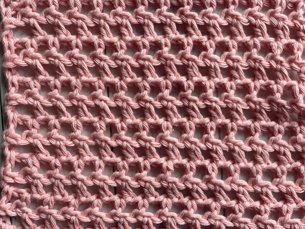 close up of the half double crochet mesh stitch