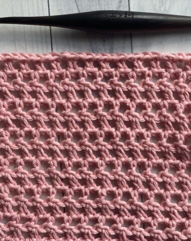 half double crochet mesh stitch shown in pink yarn