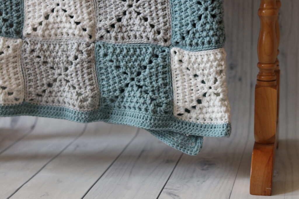simple edging on a checkered crochet blanket