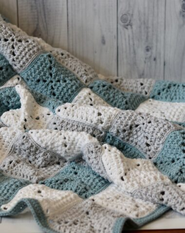 textured square blanket in blue grey and white