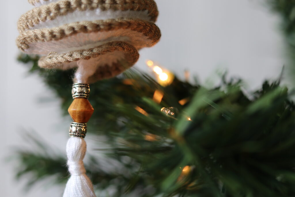 close up of bead and tassel on crochet spinner