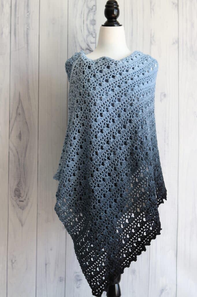 crochet lace shawl in blue yarn