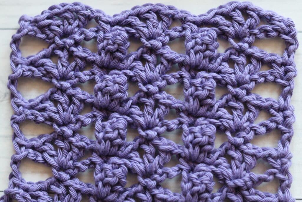 crochet fan and popcorn stitch show in purple yarn