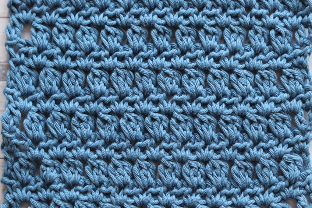 a swatch of the zigzag lozenge stitch in blue
