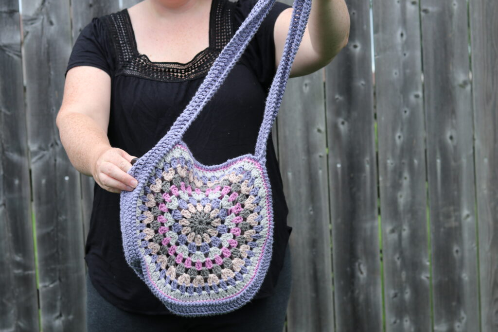 purple and pink crochet granny square bag