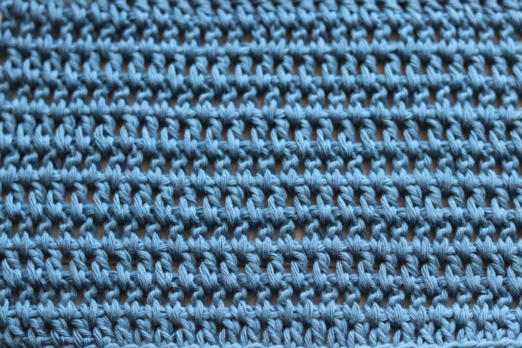 A swatch of the wide double crochet stitch in blue yarn