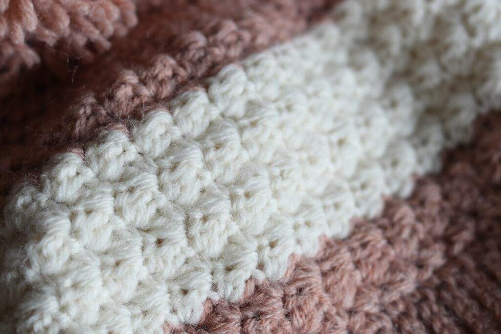 close up of the crochet stitches in the winterberry beanie