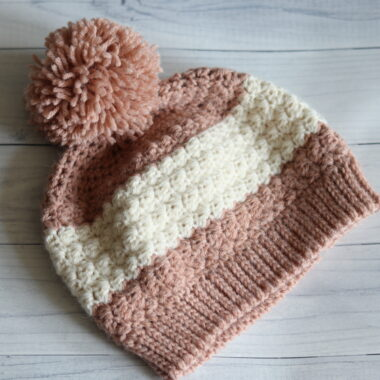pink crochet hat with a white stripe