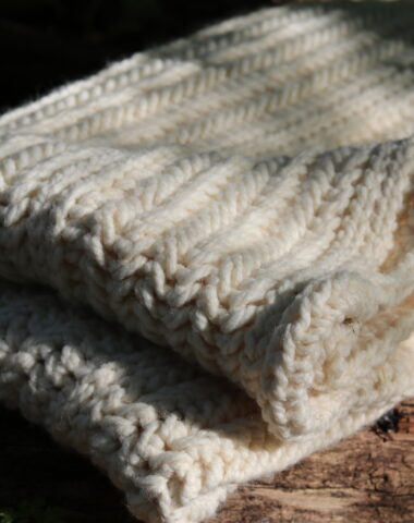 white crochet blanket made with super bulky weight yarn