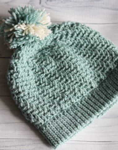 teal colour textured crochet beanie with pompom