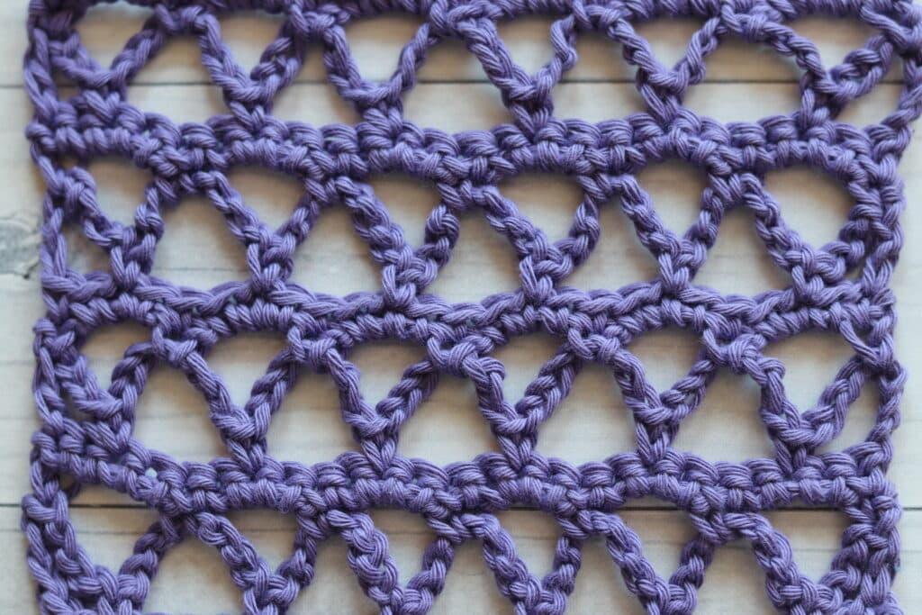 the Ruled Lattice crochet stitch in purple yarn