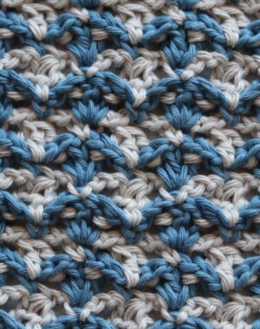 the crochet fleur de lys stitch in blue and white